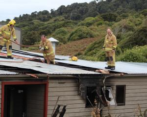 Firefighters from Bluff and Invercargill check for hot spots after extinguishing a fire at the...