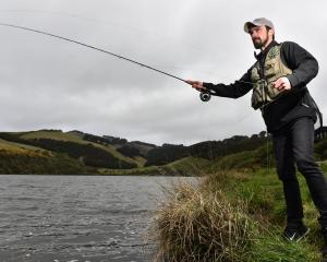 Otago Anglers' Association senior vice-president Chris Fahey fishes at Tomahawk Lagoon in Dunedin...