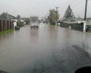 Surface flooding on Sheehan Ave in Papakura. Photo: NZ Herald