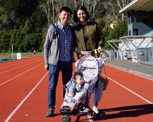Symond Lim with wife Peili and baby Brooklyn, at the Caledonian Ground on Saturday. Photo: Wayne...