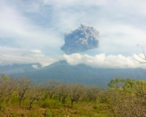 Mount Barujari, located inside Mount Rinjani volcano, is seen erupting from Bayan district, North...