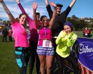 Blind athlete Hannah Pascoe (No 85), of Invercargill, celebrates with Achilles International New...