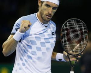 Argentina's Leonardo Mayer celebrates against Great Britain's Dan Evans. Photo: Reuters