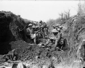New Zealand troops take a break in the trenches. Photo from the Alexander Turnbull Library.