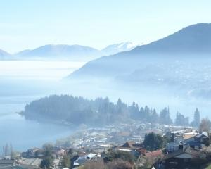 A burn-off across Lake Wakatipu smothers Queenstown in smoke yesterday. PHOTO: DAVID WILLIAMS