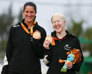 Laura Thompson (left) and Emma Foy of New Zealand receive their bronze medals after the Women's...