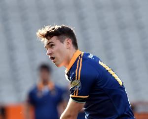 Otago first five-eighth Fletcher Smith shows his kicking style in a match against Tasman at...