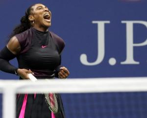 Serena Williams of the United States reacts against Simona Halep of Romania (not pictured) on day...