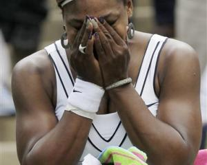 Serena Williams of the US reacts after defeating France's Aravane Rezai in their first-round...