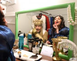 Peter Storer (King Arthur) and Alethea Chittenden (The Lady of the Lake) touch up their stage...