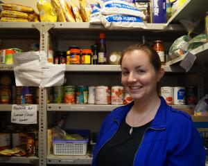 Presbyterian Support social worker Nicole Kettings stands inside the organisation's foodbank....