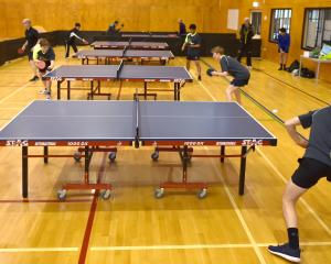 Table tennis players in action at Kaikorai Valley College on Wednesday night. Photo: Gregor...