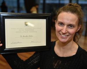 University of Otago lecturer Dr Annika Bokor with her teaching award. Photo by Gregor Richardson.
