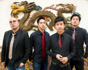 Members of the Portland, Oregon-based Asian-American rock band The Slants. Photo: Reuters