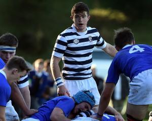 Otago Boys' High School halfback Tim Hogan behind his pack in an interschool match against...