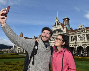 Tourists Eric Valck and Melissa Asselman visit the Dunedin Railway Station as tourism in the...