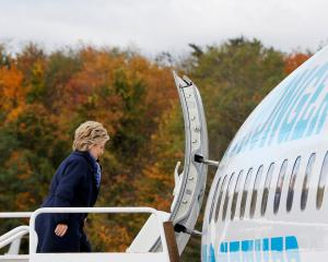 Hillary Clinton boards her campaign plane in White Plains, New York. Photo Reuters