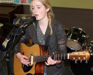 Musician and anti-bullying campaigner Janie Shaw (18) rehearses a folk ballad at the Dunstan High...