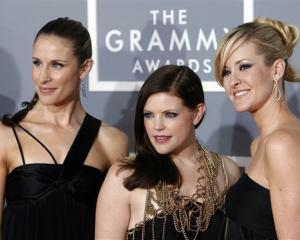 A 2007 AP file photo of the Dixie Chicks, Emily Robison, left, Natalie Maines, center, and Martie...