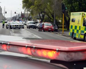 Emergency services work at the scene of a crash where an elderly pedestrian was hit by a car in...