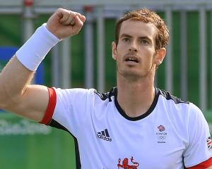 Andy Murray of Britain celebrates after winning his match against Steve Johnson (USA). Photo:...