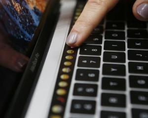 Apple announced new features, like touch keys for it's new MacBook Pro computer. Photo: Reuters