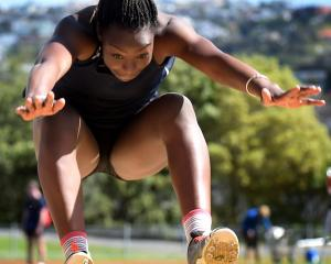 Atipa Mabonga (17), of the Otautau club, jumps during the women's triple jump on Athletics Otago...