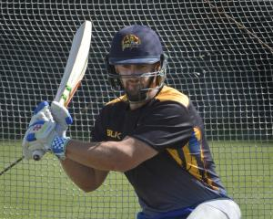 Otago top-order batsman Neil Broom looks to sweep the ball during a training session at...