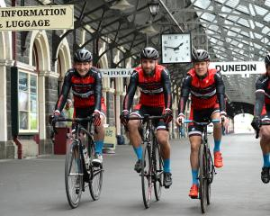 Cycle World team members (from left) Chris Latta, Tom Kaminszky, Paul Gough and Chris Harvey roll...