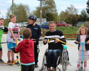 Kaitangata Skate Park Development Group chairman Dallas Storer cuts the ribbon at the opening of...