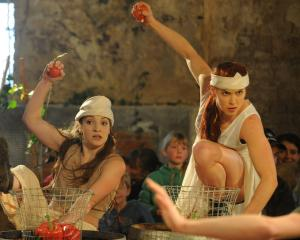 Dancers Sarah Gatzonis (left) and Emma Coppersmith throw fruit in the Arts Festival performance...