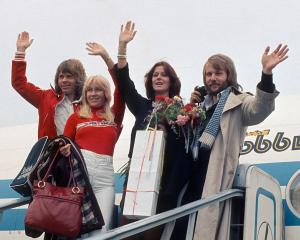 ABBA arrive for a tour of the US in October 1976. Photo Getty
