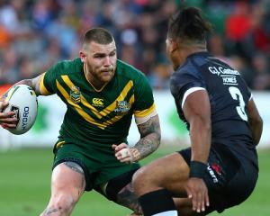 Australia's Josh Dugan looks to get past New Zealand's Solomone Kata. Photo: Getty Images