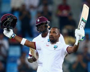 Darren Bravo celebrates reaching his century against Pakistan. Photo Getty