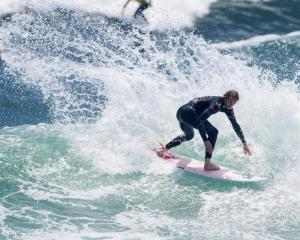 JC Susan in action at the World Surfing Games in Peru. Photo by ISA/Rommel Gonzales.