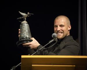 Jossi Wells with the trophy for overall athlete of the year at the New Zealand snowsports awards...