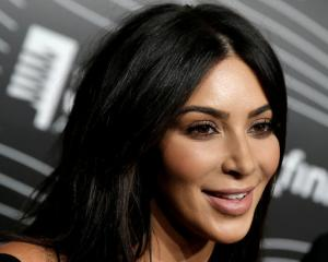 Kim Kardashian West was held at gunpoint by two men in her hotel room in Paris. Photo: Reuters