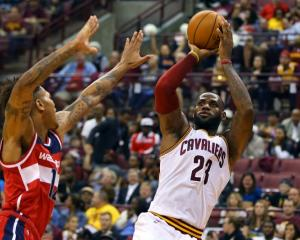 Cavaliers forward LeBron James shoots over Washington Wizards swingman Kelly Oubre during a pre...