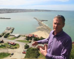 Waitaki Mayor Gary Kircher inspects a Cape Wanbrow site that could be used as a starting point...