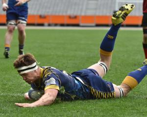 Otago lock Ryan Thompson scores for Otago B in its win against Canterbury Country at Forsyth Barr...