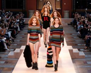 Models on the runway strut out in tribute of Sonia Rykiel. Photo: Reuters