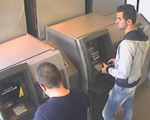Emanoil Pirjol (left) and Ionut Bilea caught on camera using skimmed cards at an ATM. Photo via...