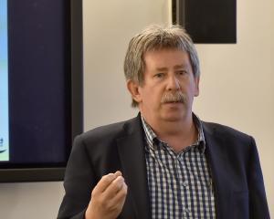Deputy commissioner Richard Thomson speaks at yesterday's public meeting at Dunedin Hospital....