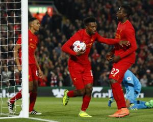 Daniel Sturridge (with ball) celebrates scoring Liverpool's first goal. Photo: Reuters