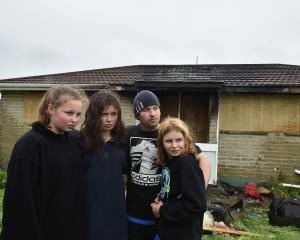 Chloe (13), Alyssa (16), Brendon (38) and Savannah (11) Carter in front of their Mulford St house...