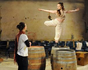 Dancer Sarah Gatzonis rehearses her role of Dionysus in the Athenaeum basement yesterday for the...