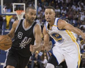 Spurs guard Tony Parker drives past Warriors guard Stephen Curry. Photo: Reuters