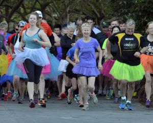 Competitors wearing tutus start the Dunedin parkrun at Dunedin Botanic Garden on Saturday. Photo:...
