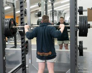Dunedin powerlifter Tyla Watt (17) trains at Anytime Fitness yesterday after being named in the...