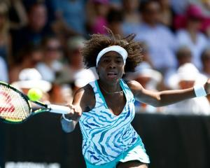 Venus Williams plays a forehand against Caroline Wozniacki. Photo Getty Images